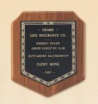 American Walnut Shield Plaque with a Black Brass Plate. Employee Awards
